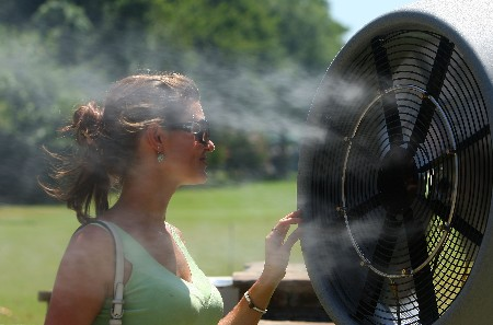 TULSA, OK - AUGUST 09:  A golf fan cools herself during the first round of the 89th PGA Championship at the Southern Hills Country Club on August 9, 2007 in Tulsa, Oklahoma.  (Photo by Stuart Franklin/Getty Images)
