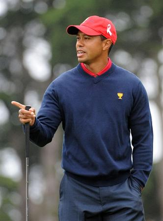 SAN FRANCISCO - OCTOBER 11:  Tiger Woods of the USA Team reacts to his putt on the fourth hole during the Day Four Singles Matches of The Presidents Cup at Harding Park Golf Course on October 11, 2009 in San Francisco, California.  (Photo by Harry How/Getty Images)
