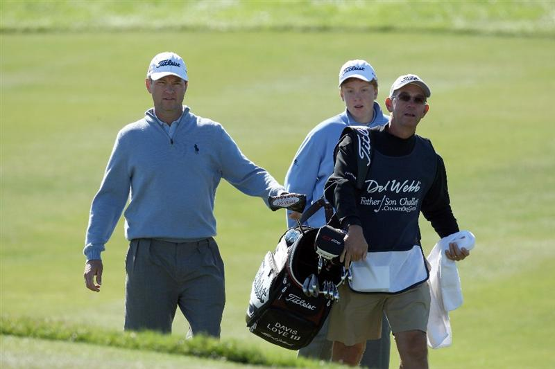 CHAMPIONS GATE, FL - DECEMBER 07: Davis Love III and his son Dru Love approach the green at the 8th hole with Mike Hulbert on the bag during the final round of the Del Webb Father Son Challenge on the International Course at Champions Gate Golf Club on December 7, 2008 in Champions Gate, Florida.  (Photo by David Cannon/Getty Images)
