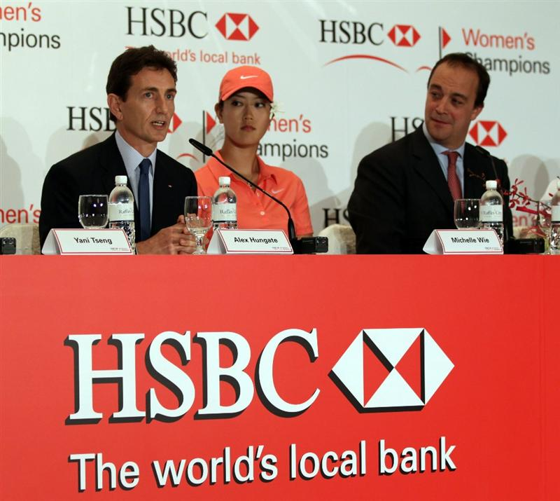 SINGAPORE - FEBRUARY 22:  Alex Hungate, Group General Manager and Chief Executive Officer HSBC Singapore, Michelle Wie of the USA and Giles Morgan, Giles Morgan, HSBC Group Head of Sponsorship during a press conference at the Fairmont Hotel prior to the HSBC Women's Champions at Tanah Merah Country Club  on February 22, 2011 in Singapore, Singapore.  (Photo by Ross Kinnaird/Getty Images)