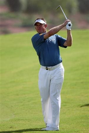 DUBAI, UNITED ARAB EMIRATES - NOVEMBER 21:  Lee Westwood of England plays his second shot at the 3rd hole during the third round of the Dubai World Championship, on the Earth Course, Jumeirah Golf Estates on November 21, 2009 in Dubai, United Arab Emirates  (Photo by David Cannon/Getty Images)