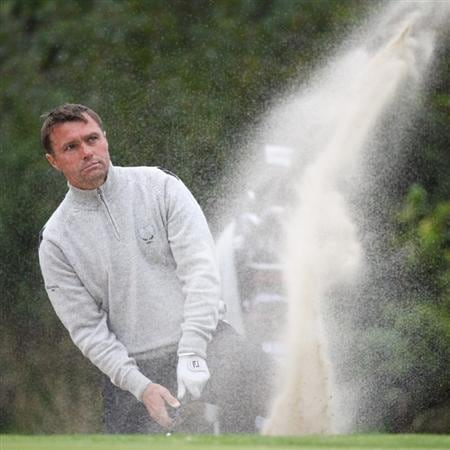 DUMBARTON, SCOTLAND - SEPTEMBER 18:  Paul Simpson of Great Britain chips out the bunker on the  14th green in the afternoon four ball matches at The Carrick on Loch Lomond on September 18, 2009 in Dumbarton, Scotland.  (Photo by Jeff J Mitchell/Getty Images)