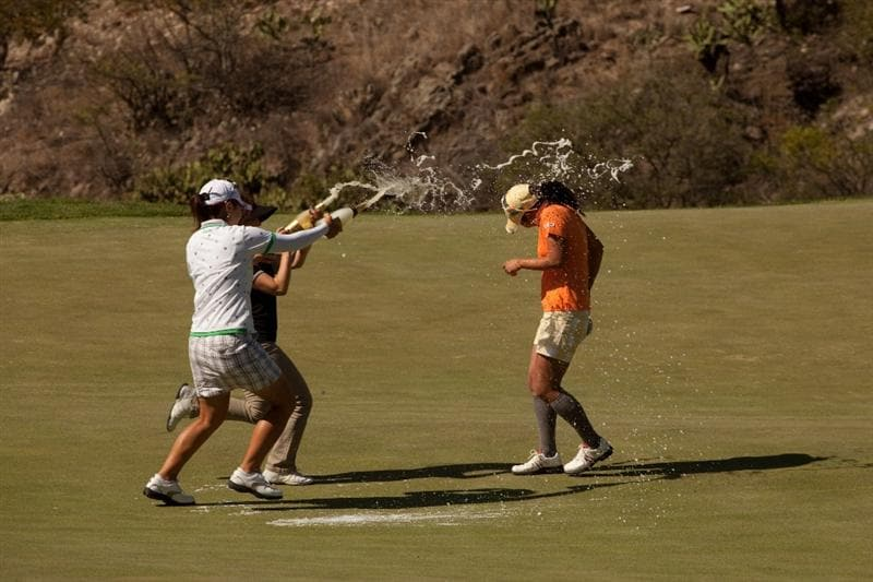 MORELIA, MEXICO - MAY 2: Mika Miyazato (in white) and Kie Ito of Japan spray Ai Miyazato of Japan with champagne following the fourth round of the Tres Marias Championship at the Tres Marias Country Club on May 2, 2010 in Morelia, Mexico. (Photo by Darren Carroll/Getty Images)