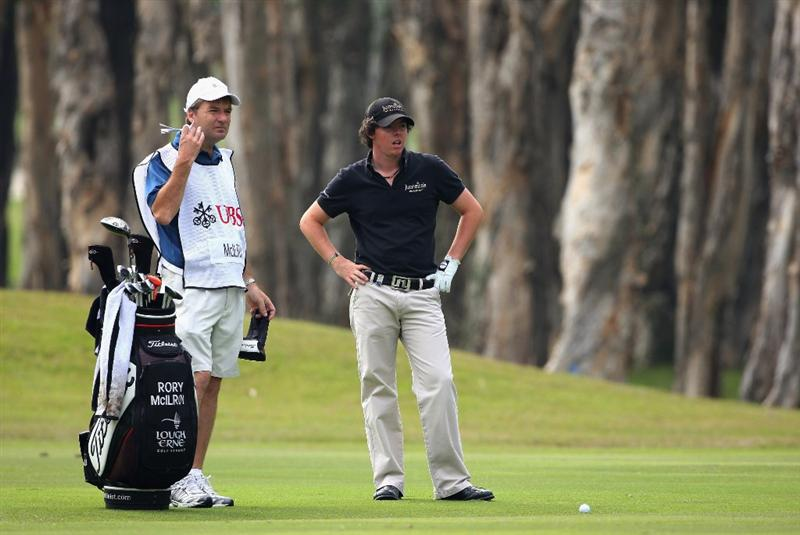HONG KONG, CHINA - NOVEMBER 22:  Rory McIlroy of Nothern Ireland and caddy J.P Fitzgerald on the sixth hole during the third round of the UBS Hong Kong Open at the Hong Kong Golf Club on November 22, 2008 in Fanling, Hong Kong.  (Photo by Stuart Franklin/Getty Images)