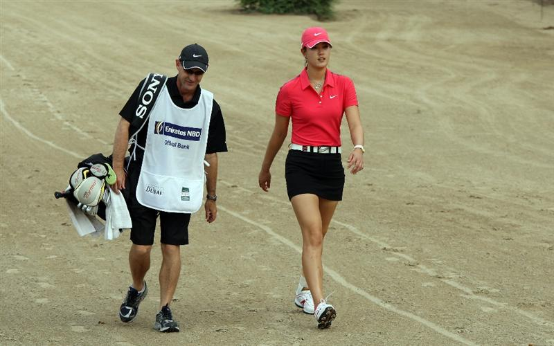 DUBAI, UNITED ARAB EMIRATES - DECEMBER 12:  Michelle Wie of the USA walks to her second shot at the 14th hole during the final round of the Dubai Ladies Masters, on the Majilis Course at the Emirates Golf Club on December 12, 2009 in Dubai, United Arab Emirates.  (Photo by David Cannon/Getty Images)