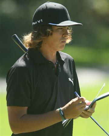 LEMONT, IL - SEPTEMBER 08:  Rickie Fowler checks his yardage book during the pro-am prior to the start of The BMW Championship at the Cog Hill Golf & Country Club on September 8, 2010 in Lemont, Illinois.  (Photo by Scott Halleran/Getty Images)