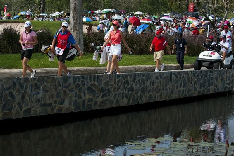 CHON BURI, THAILAND - FEBRUARY 20:  Yani Tseng of Taiwan and Michelle Wie of USA cross a bridge on the 11th hole during day four of the LPGA Thailand at Siam Country Club on February 20, 2011 in Chon Buri, Thailand.  (Photo by Victor Fraile/Getty Images)