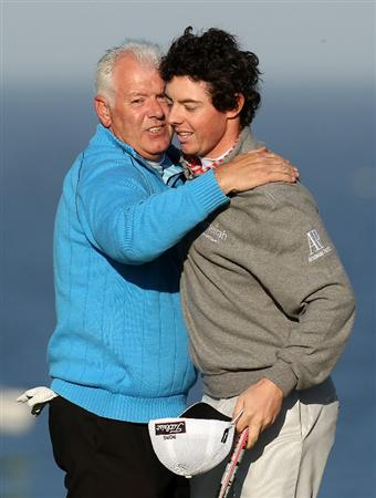 KINGSBARNS, SCOTLAND - OCTOBER 07:  Rory McIlroy of Northern Ireland with his father and playing partner Gerry McIlroy on the 18th green during the first round of The Alfred Dunhill Links Championship at Kingsbarns Golf Links on October 7, 2010 in Kingsbarns, Scotland.  (Photo by Ross Kinnaird/Getty Images)