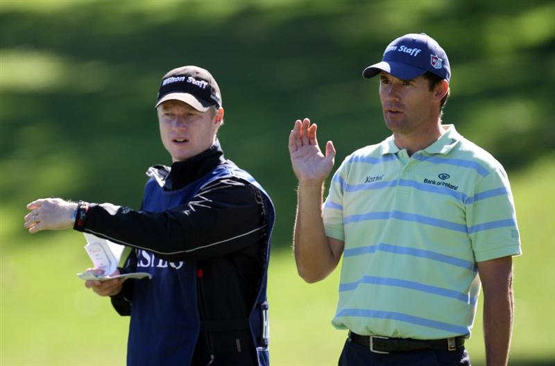 SOTOGRANDE, SPAIN - OCTOBER 29:  Padraig Harrington of Ireland and his caddie Ronan Flood have a discussion  the par four 10th hole during the pro-am event prior to the Volvo Masters at the Valderrama Golf Club on October 29, 2008 in Sotogrande, Spain  (Photo by Ross Kinnaird/Getty Images)