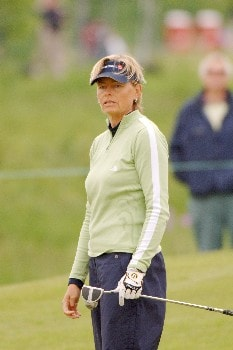 Liselotte Neumann follows a fairway shot  April 30 in  the rain-delayed third  round of the 2005 Franklin American Mortgage Championship in Franklin, Tn.Photo by Al Messerschmidt/WireImage.com
