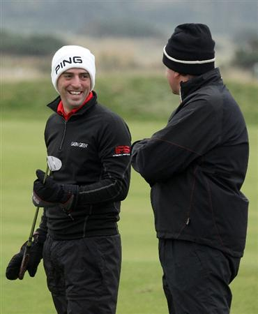 CARNOUSTIE, SCOTLAND - OCTOBER 09:  John Parry of England with his playing partner businessman Simon Andrews on the third green during the third round of The Alfred Dunhill Links Championship at the Carnoustie Golf Links on October 9, 2010 in Carnoustie, Scotland.  (Photo by David Cannon/Getty Images)