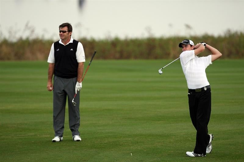 CHAMPIONS GATE, FL - DECEMBER 06:  Nick Faldo of England watches his son Matthew Faldo hit his second shot on the 1st hole during the first round of the Del Webb Father Son Challenge on the International Course at Champions Gate Golf Club on December 6, 2008 in Champions Gate, Florida.  (Photo by David Cannon/Getty Images)