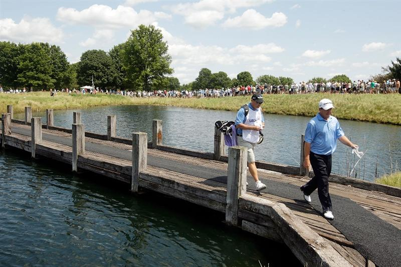 CARMEL, IN - AUGUST 02:  Fred Funk of the USA walks across a bridge to the teebox on the 4th hole during the final round of the 2009 U.S. Senior Open on August 2, 2009 at Crooked Stick Golf Club in Carmel, Indiana.  (Photo by Jamie Squire/Getty Images)