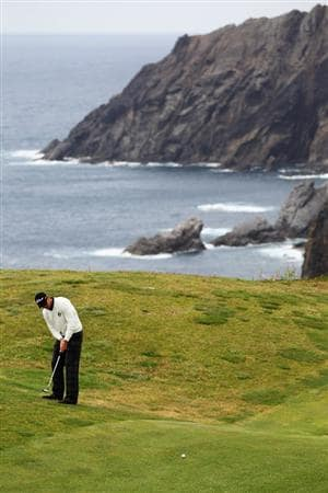 PORTO SANTO ISLAND, PORTUGAL - MAY 21:  Lloyd Saltman of Scotland putts on the 13th green during day three of the Madeira Islands Open on May 21, 2011 in Porto Santo Island, Portugal.  (Photo by Dean Mouhtaropoulos/Getty Images)