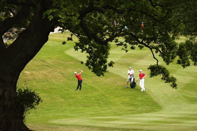 WENTWORTH, ENGLAND - MAY 23:  Miles Tunnicliff of England plays his second shot on the 7th hole during the Third Round of the BMW PGA Championship at Wentworth on May 23, 2009 in Virginia Water, England.  (Photo by Ross Kinnaird/Getty Images)