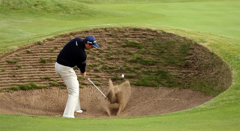 CARNOUSTIE, SCOTLAND - OCTOBER 01: David Howell of England plays from a bunker on the par five 14th hole during the first round of The Alfred Dunhill Links Championship at Carnoustie Golf Club on October 1, 2009 in Carnoustie, Scotland. (Photo by Ross Kinnaird/Getty Images