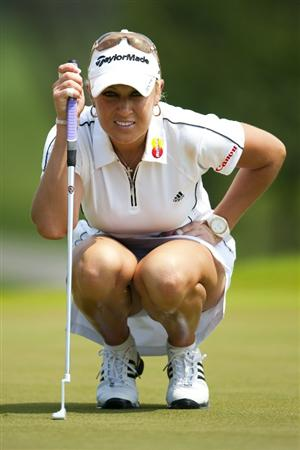 CHON BURI, THAILAND - FEBRUARY 19:  Natalie Gulbis of the USA lines up a putt on the 1st green during day three of the LPGA Thailand at Siam Country Club on February 19, 2011 in Chon Buri, Thailand.  (Photo by Victor Fraile/Getty Images)