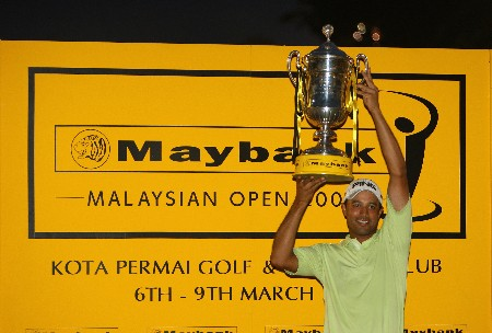 KUALA LUMPUR, MALAYSIA - MARCH 09:  Arjun Atwal of India poses with the trophy after winning the Maybank Malaysian Open held at the Kota Permai Golf & Country Club on March 9, 2008 in Kuala Lumpur, Malaysia.  (Photo by Andrew Redington/Getty Images)