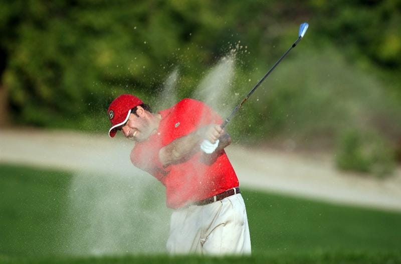 DUBAI, UNITED ARAB EMIRATES - JANUARY 29:  Jose Maria Olazabal of Spain hits his second shot at the par 4, 9th hole during the first round of the 2009 Dubai Desert Classic on the Majilis Course at the Emirates Golf Club on January 29, 2009 in Dubai, United Arab Emirates  (Photo by David Cannon/Getty Images)