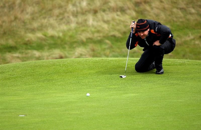BALTRAY, IRELAND - MAY 16:  Alastair Forsyth of Scotland lines up a putt on the sixth hole during the third round of The 3 Irish Open at County Louth Golf Club on May 16, 2009 in Baltray, Ireland.  (Photo by Andrew Redington/Getty Images)