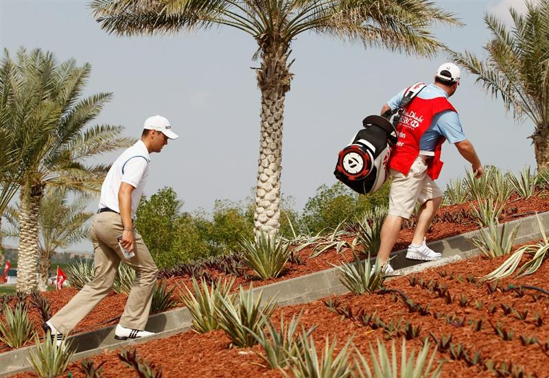 ABU DHABI, UNITED ARAB EMIRATES - JANUARY 23:  Martin Kaymer of Germany climbs the steps to the third tee during the final round of the 2011 Abu Dhabi HSBC Golf Championship at the Abu Dhabi Golf Club on January 23, 2011 in Abu Dhabi, United Arab Emirates.  (Photo by Scott Halleran/Getty Images)