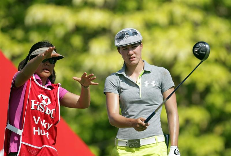 SINGAPORE - FEBRUARY 25:  Vicky Hurst of the USA with her caddie Koko Hurst during the second round of the HSBC Women's Champions at Tanah Merah Country Club  on February 25, 2011 in Singapore, Singapore.  (Photo by Ross Kinnaird/Getty Images)