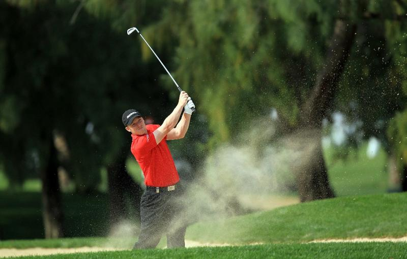 DUBAI, UNITED ARAB EMIRATES - FEBRUARY 11:  David Horsey of England plays his second shot at the 1st hole during the second round of the 2011 Omega Dubai Desert Classic on the Majilis Course at the Emirates Golf Club on February 11, 2011 in Dubai, United Arab Emirates.  (Photo by David Cannon/Getty Images)