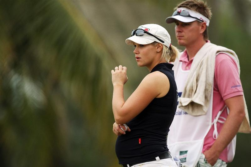 DUBAI, UNITED ARAB EMIRATES - DECEMBER 11:  Minea Blomqvist of Finland with her boyfriend caddie Roope Kakko of Finland at the 11th hole during the third round of the Dubai Ladies Masters, on the Majilis Course at the Emirates Golf Club on December 11, 2009 in Dubai, United Arab Emirates.  (Photo by David Cannon/Getty Images)