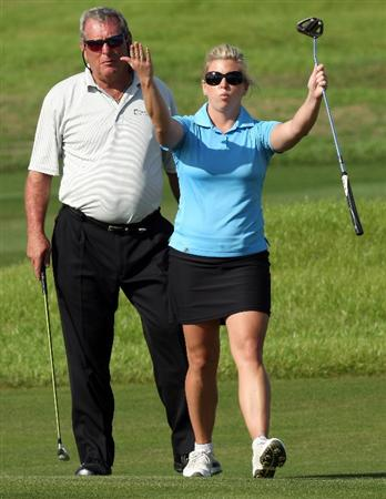 CHAMPIONS GATE, FL - DECEMBER 06:  Fuzzy Zoeller of the USA watches his daughter Gretchen Zoeller as she urges on her putt at the 18th hole during the first round of the Del Webb Father Son Challenge on the International Course at Champions Gate Golf Club on December 6, 2008 in Champions Gate, Florida.  (Photo by David Cannon/Getty Images)