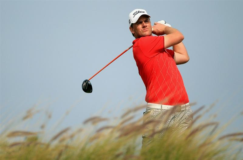 DOHA, QATAR - FEBRUARY 06:  Robert Karlsson of Sweden hits his tee-shot on the ninth hole during the final round of the Commercialbank Qatar Masters held at Doha Golf Club on February 6, 2011 in Doha, Qatar.  (Photo by Andrew Redington/Getty Images)