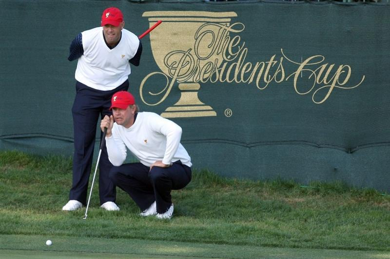 SAN FRANCISCO - OCTOBER 09:  Lucas Glover of the USA team and his partner Stewart Cink of the USA line up a birdie putt at the 15th hole during the Day Two Fourball Matches in The Presidents Cup at Harding Park Golf Course on October 9, 2009 in San Francisco, California  (Photo by David Cannon/Getty Images)