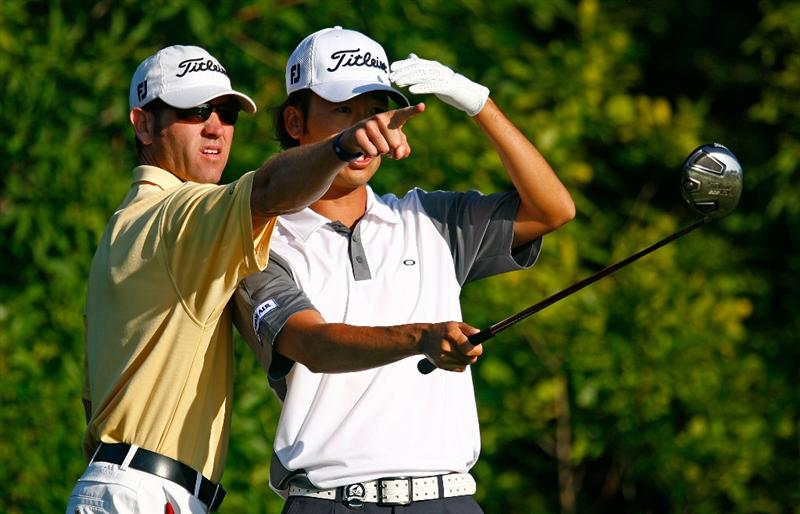 CHASKA, MN - AUGUST 12:  Kevin Na chats with his caddie Kenny Harms during the third preview day of the 91st PGA Championship at Hazeltine National Golf Club on August 12, 2009 in Chaska, Minnesota.  (Photo by Scott Halleran/Getty Images)