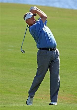 VILAMOURA, PORTUGAL - OCTOBER 17:  Colin Montgomerie of Scotland plays his second shot on the 18th hole during the third round of the Portugal Masters at the Oceanico Victoria Golf Course on October 17, 2009 in Vilamoura, Portugal.  (Photo by Andrew Redington/Getty Images)