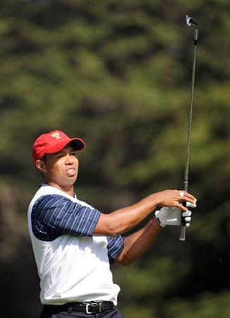SAN FRANCISCO - OCTOBER 09:  Tiger Woods of the USA Team watches his shot on the third hole during the Day Two Fourball Matches of The Presidents Cup at Harding Park Golf Course on October 9, 2009 in San Francisco, California.  (Photo by Harry How/Getty Images)