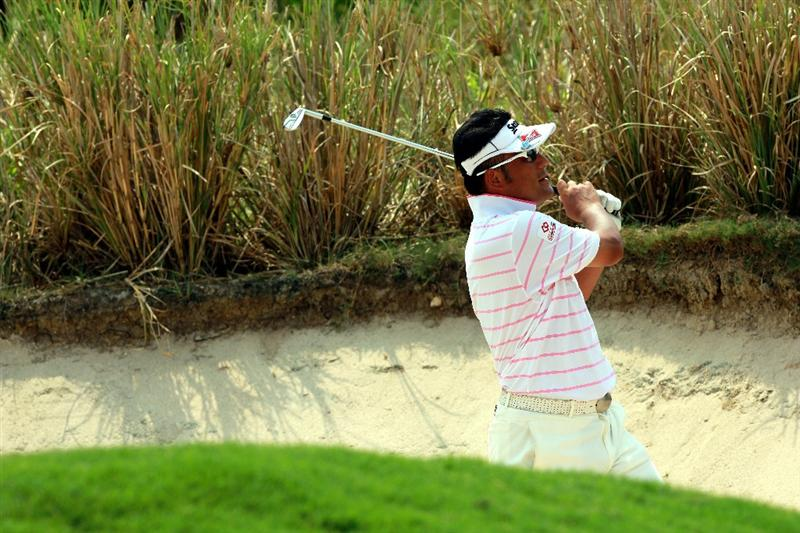 CHON BURI, THAILAND - FEBRUARY 24: Takao Nogami of Japan watches his bunker shot on the 7th hole during day one of The Open Championship Asia Final Qualifying tournament at Amata Spring Country Club on February 24, 2011 in Chon Buri, Thailand.  (Photo by Stanley Chou/Getty Images)