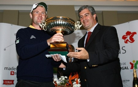 MADEIRA, PORTUGAL - MARCH 23:  Alastair Forsyth of Scotland is presented with the trophy after winning the Madeira Islands Open BPI 2008 at Clube De Golf Santo Da Serra on March 23, 2008 in Madeira, Portugal.  (Photo by Ryan Pierse/Getty Images)