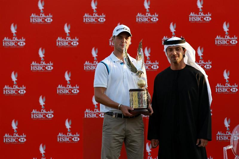 ABU DHABI, UNITED ARAB EMIRATES - JANUARY 23:  Martin Kaymer of Germany is presented with the trophy by His Highness Sheikh Hazza Bin Zayed Al Nahyan The National Security Advisor, Vice Chairman of the Executive Council, and Chairman of the Abu Dhabi Sports Council after winning the 2011 Abu Dhabi HSBC Golf Championship held at the Abu Dhabi Golf Club on January 23, 2011 in Abu Dhabi, United Arab Emirates.  (Photo by David Cannon/Getty Images)