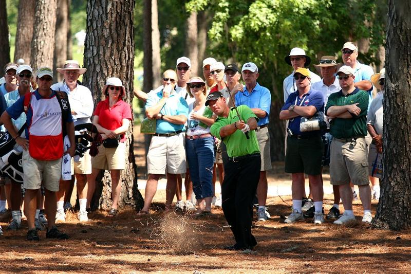 PONTE VEDRA BEACH, FL - MAY 08:  Alex Cejka of Germany plays his second shot on the 16th hole in front of a gallery of fans during the second round of THE PLAYERS Championship on THE PLAYERS Stadium Course at TPC Sawgrass on May 8, 2009 in Ponte Vedra Beach, Florida.  (Photo by Richard Heathcote/Getty Images)