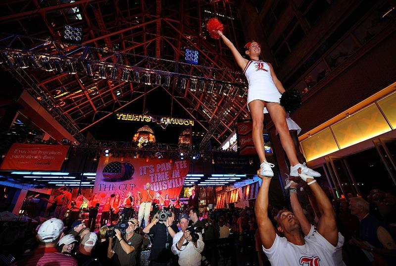 LOUISVILLE, KY - SEPTEMBER 18: University of Louisville cheerleaders and golf fans at the downtown Ryder Cup pep rally prior to the start of the 2008 Ryder Cup on September 18, 2008 in Louisville, Kentucky. (Photo by Sam Greenwood/Getty Images)