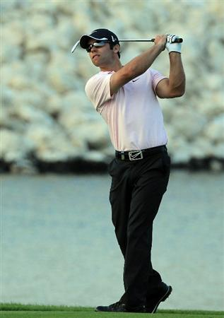 BAHRAIN, BAHRAIN - JANUARY 30:  Paul Casey of England plays his second shot at the 18th hole during the final round of the 2011 Volvo Champions held at the Royal Golf Club on January 30, 2011 in Bahrain, Bahrain.  (Photo by David Cannon/Getty Images)