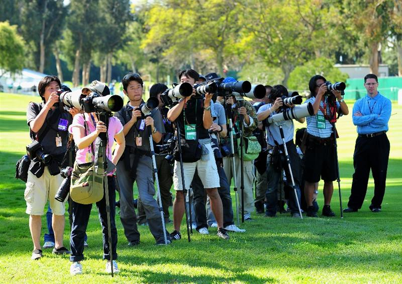 PACIFIC PALISADES, CA - FEBRUARY 19:  Photographers line up to shoot Ryo Ishikawa of Japan during the first round of the Northern Trust Open at the Riviera Country Club February 19, 2009 in Pacific Palisades, California.  (Photo by Stuart Franklin/Getty Images)