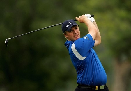 MALELANE, SOUTH AFRICA - DECEMBER 09:  Ross McGowan of England plays his second shot into the second green during the final round of The Alfred Dunhill Championship at The Leopard Creek Country Club on December 9, 2007 in Malelane, South Africa.  (Photo by Warren Little/Getty Images)
