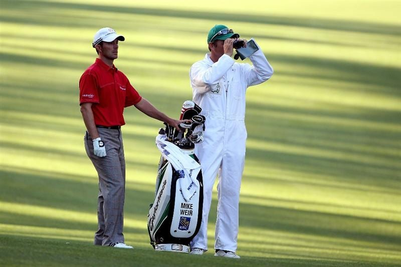 AUGUSTA, GA - APRIL 06:  Mike Weir of Canada and his caddie look on during a practice round prior to the 2010 Masters Tournament at Augusta National Golf Club on April 6, 2010 in Augusta, Georgia.  (Photo by Andrew Redington/Getty Images)
