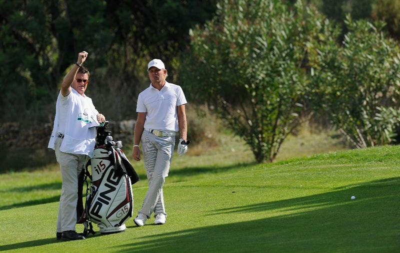CASTELLON DE LA PLANA, SPAIN - OCTOBER 22:  Jeppe Huldahl of Denmark and caddie discuss his approach shot on the 10th hole during the second round of the Castello Masters Costa Azahar at the Club de Campo del Mediterraneo on October 22, 2010 in Castellon de la Plana, Spain.  (Photo by Stuart Franklin/Getty Images)