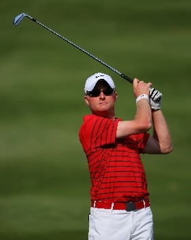 DUBAI, UNITED ARAB EMIRATES - FEBRUARY 03:  Simon Dyson of England hits his second shot on the 14th hole during the final round of the Dubai Desert Classic, on the Majilis Course at the Emirates Golf Club, on February 3, 2008 in Dubai, United Arab Emirates.  (Photo by Andrew Redington/Getty Images)