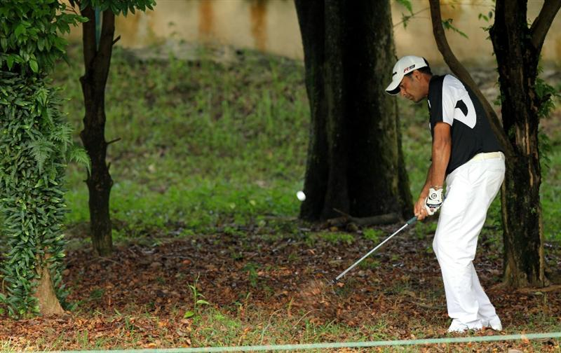 KUALA LUMPUR, MALAYSIA - OCTOBER 31: Arjun Atwal of India hits out of the rough on the 3rd hole during day four of the CIMB Asia Pacific Classic at The MINES Resort & Golf Club on October 31, 2010 in Kuala Lumpur, Malaysia. (Photo by Stanley Chou/Getty Images)