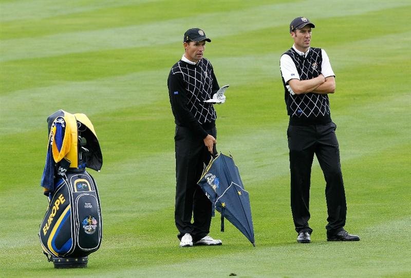 NEWPORT, WALES - OCTOBER 02:  Ross Fisher (R) and Padraig Harrington of Europe wait to play during the rescheduled Afternoon Foursome Matches during the 2010 Ryder Cup at the Celtic Manor Resort on October 2, 2010 in Newport, Wales.  (Photo by Sam Greenwood/Getty Images)