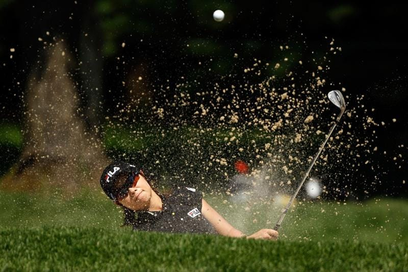 BETHLEHEM, PA - JULY 12:  Eun Hee Ji chips out of a bunker on the 7th hole during the final round of the 2009 U.S. Women's Open at Saucon Valley Country Club on July 12, 2009 in Bethlehem, Pennsylvania.  (Photo by Chris Graythen/Getty Images)
