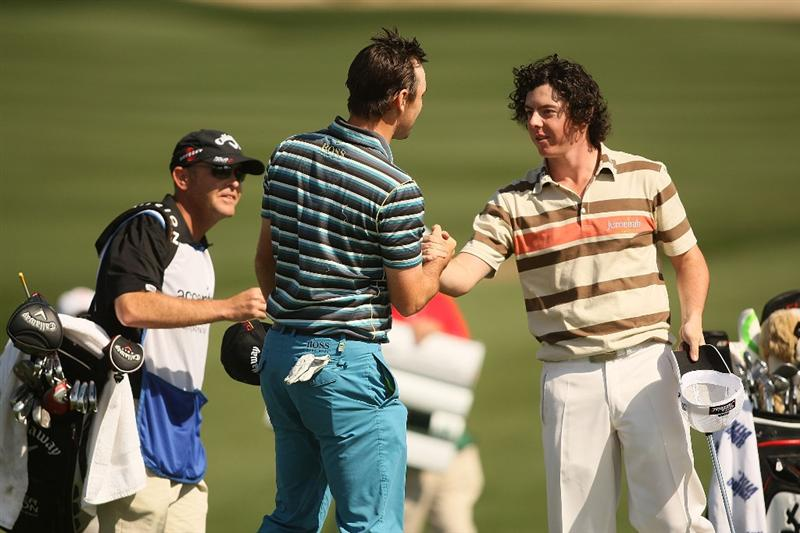 MARANA, AZ - FEBRUARY 18:   Rory Mcllroy of Northern Ireland congratulates Oliver Wilson of England after their round on the second playoff hole during round two of the Accenture Match Play Championship at the Ritz-Carlton Golf Club on February 18, 2010 in Marana, Arizona.  (Photo by Darren Carroll/Getty Images)