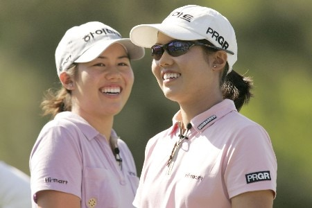 Aree and Naree Song share a laugh on the practice range during the Pro-Am day at the Michelob Ultra Open at the Kingsmill Resort River course on May 4, 2005Photo by Pete Fontaine/WireImage.com